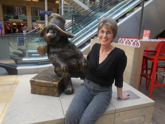 Karen Jankel today, with the famous statue at Paddington Station
